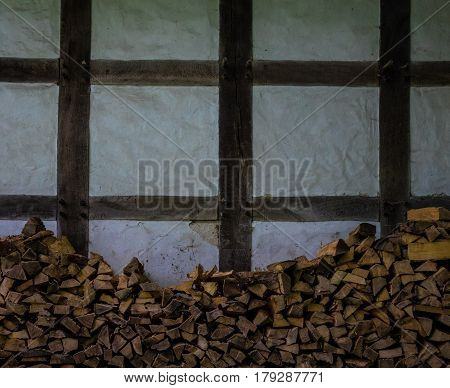 Stack Of Old Firewood At Half-timbered House