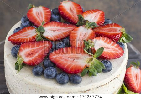 Dietary cake with berries on a wooden tray. Delicious useful. Minimum calories