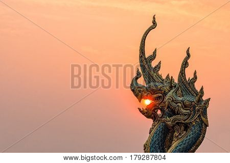 Beautiful Statue At Temple Sirindhorn Wararam Phuproud In Ubon Ratchathani Province With Sunset Sky,