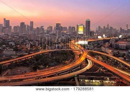 Modern office buildings condominium in big city downtown with Motorway Expressway Freeway the infrastructure for transportation in modern city urban view at twilight time