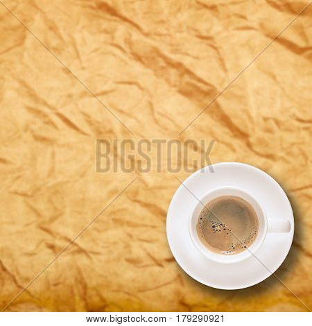 Top view of espresso black coffee in Coffee Cup and saucer on Rough wrinkled paper texture background. Elegant Design with Space for placement your text, mock up for enjoy drinking coffee concept