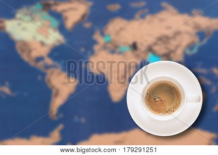 Top view of espresso black coffee in Coffee Cup and saucer on vintage world map background. Elegant Design with Space for placement your text, mock up for enjoy drinking coffee and travel concept