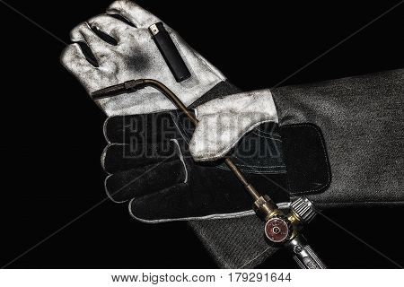 Heat resistant gloves for welding of plastic pipes isolated on a white background. Used to install plumbing and heating pipes made of polypropylene