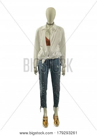 Full-length female mannequin dressed in shirt and ripped jeans with pearl beads isolated on white background. No brand names or copyright objects.