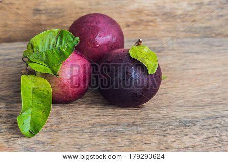 Fresh Chrysophyllum Cainito Fruits On Wood Background