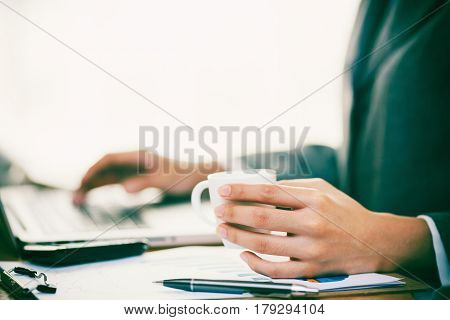 Businesswoman work with computer and drink coffee