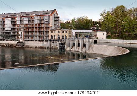 Kempten, Germany - April 25, 2014: Modern hydroelectric power plant on the river Allgau, Bayern, Germany.