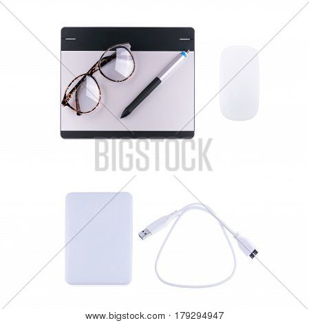 graphic tablet with pen, retro glass, wireless computer mouse and external harddisk isolated on white background. Object for technology and gadget concept