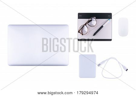 Top view of laptop, graphic tablet with pen, retro glass, wireless computer mouse and external harddisk isolated on white background. Object for technology and gadget concept