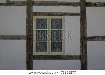 The Wall And Window Of An Old Farmhouse