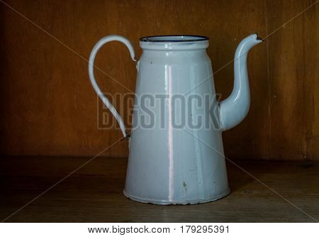 The Old And Ancient Kettle On A Table