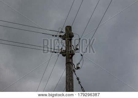 The Electricity Wooden Pylon Against A Sky