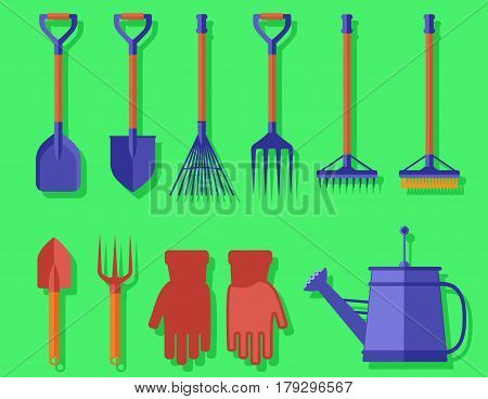 isolated bright colorful garden tools on green background for landscaping or harvesting