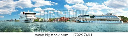 STOCKHOLM, SWEDEN - JUNE 25: View to Stockholm from seaside on June 25, 2016 in Sweden. Two ferries are at bay near stockholm on beautiful sunny day in summer.