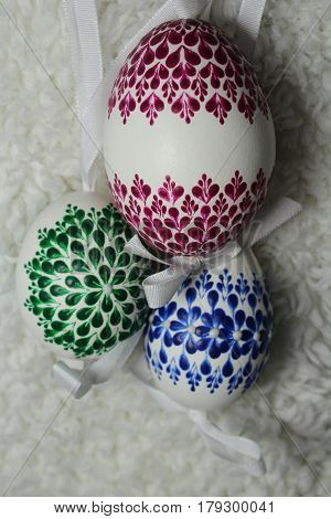 Painted Easter eggs on white sheep´s leather.