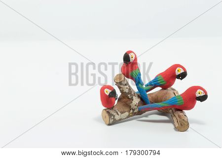 Four Red, Blue And Green Macaws Perched On A Wood Trunk Isolated In White Background