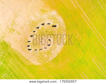 Aerial view of ancient esoteric geomancy symbol in green wheat field. Mystery of Czech countryside. Spring landscape near Pilsen. Czech Republic, Central Europe.