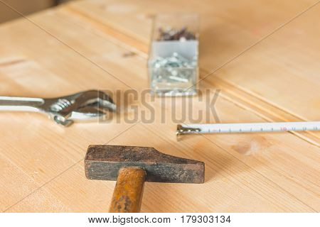 Set Of Tools On A Workbench With Nails