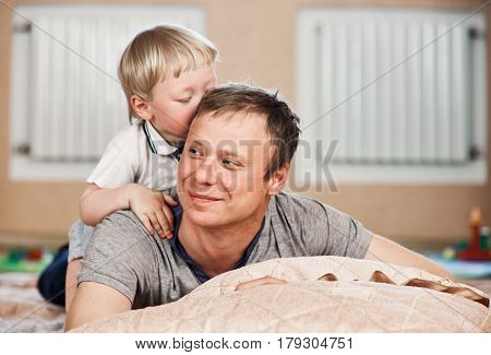 Different generations. Young father and his son. indoor home freetime