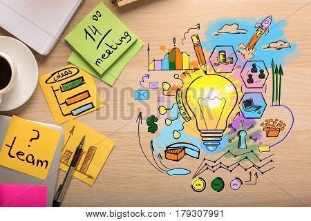 Top view of creative business sketch on wooden desktop with coffee cup stickers and other supplies. Idea concept