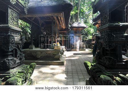 Ubud indonesia - 10 February 2013: Women praying at the balinese temple in Ubud Sacred Monkey Forest on Bali Indonesia
