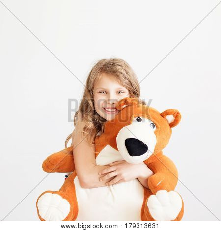 Little Girl With Big Teddy Bear Having Fun Laughing Isolated On White