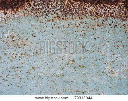 Abstract blue texture with grunge cracks. Cracked paint on a metal surface. Urban background with rough paint transitions. The cracks grunge urban background.