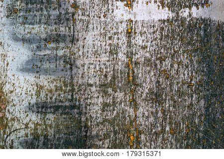 Dark metal texture with grunge cracks. Cracked paint on a metal surface. Urban background with transitions of rough paint.