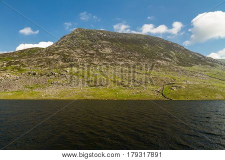 Pen Yr Ole Wen Mountain With Lake Llyn Ogwen In The Foreground.