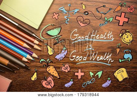 Top view of wooden desktop with colorful supplies creative sketch and writings. Health is wealth concept