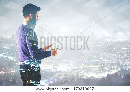 Side view of handsome businessman with document in hands on abstract city background. Double exposure