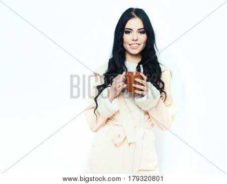 Sexy Smiling Girl In Beige Velour Bathrobe Holding Cup