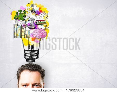 Portrait of handsome businessman with abstract drawn lamp brain and money. Business ideas concept
