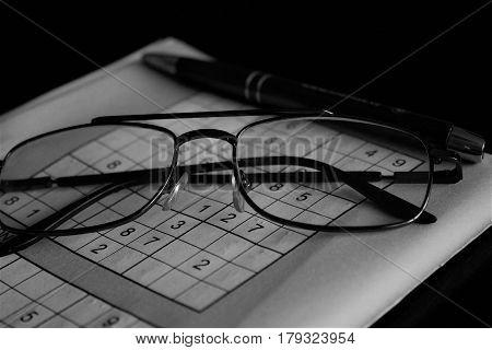 Solving Sudoku sharpens the brain - hobby - glasses pen