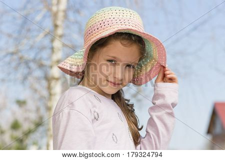 Seven years old girl with summer hat