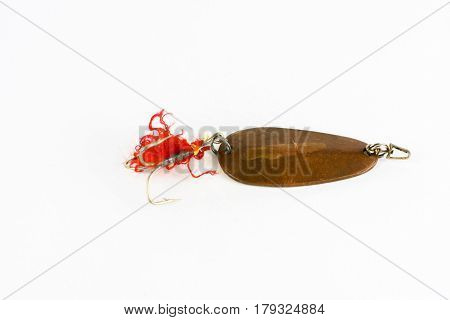 Exhibition of self-made fishing metal lures. Bait for fishing in the shape of a spoon with a hook on a white background.