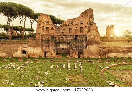 The ruins of the stadium of Domitian on the Palatine Hill at sunset in Rome, Italy