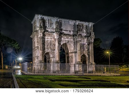 Triumphal Arch of Constantine at night in Rome, Italy