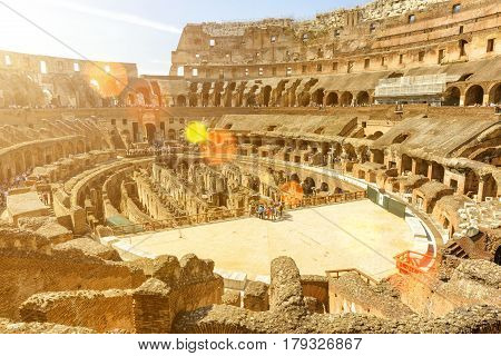 ROME, ITALY - MAY 10, 2014: Inside of Colosseum (Coliseum) in Rome. The Colosseum is an important monument of antiquity and is one of the main tourist attractions of Rome.