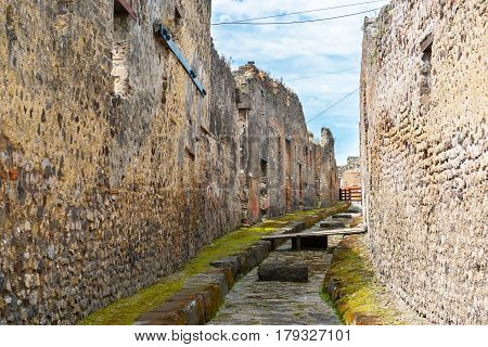 Street in Pompeii, Italy. Pompeii is an ancient Roman city died from the eruption of Mount Vesuvius in 79 AD.