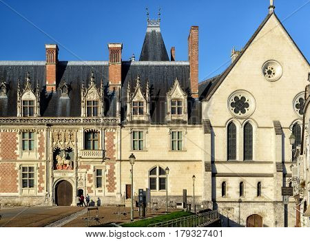BLOIS, FRANCE - SEPTEMBER 22, 2013: The chateau Royal de Blois: the facade of the Louis XII wing. This old palace is located in the Loire Valley, in the center of the city of Blois, France.
