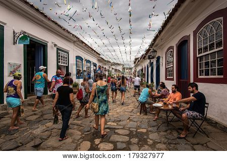 Paraty, Brazil - February 25. 2017: Old town streets are full of people visiting the historical center of the city.
