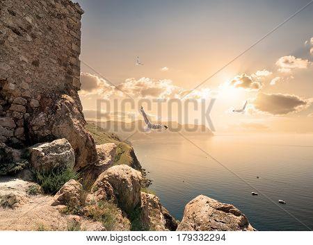 Stone tower on a mountain near sea