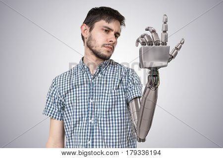 Young Man Have Robotic Hand As A Replacement For His Hand. 3D Re