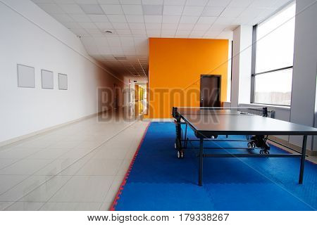 Ping pong table in a corridor