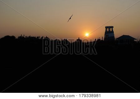 Sunset In Kovalam, Viewing Platform: Black Hill Silhouette, Lookout Tower And House Roof, Along The