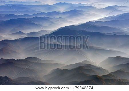 Bright Silhouettes Of Mountain Chains At Sunrise, Photographed From An Airplane: Diagonals Of Blue A