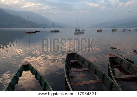 Three Boats On Lake Feva: In The Foreground Of Boat Food, Flooded With Water, In The Distance A Lot