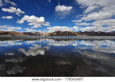 High Mountain Salt Lake Tso Kar: In A Calm Surface The Water Reflects Like In A Mirror A Blue Sky An