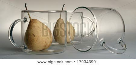 Three Large Round Transparent Glass Cups With Large Handles: One Is Turned Upside Down And Lies On I